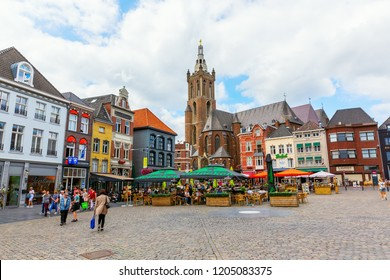Roermond, Netherlands - August 14, 2018: City square with Munsterkerk and unidentified people. Roermond received town rights in 1231. The town centre has been designated as a conservation area