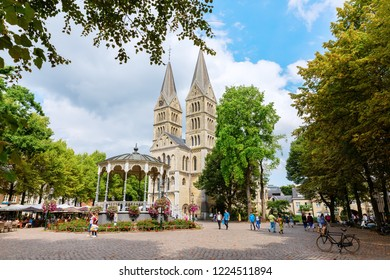 Roermond, Netherlands - August 14, 2018: historical Munsterkerk with unidentified people in Roermond. Roermond received town rights in 1231. The town centre has been designated as a conservation area