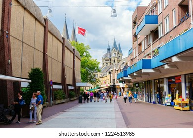 Roermond, Netherlands - August 14, 2018: shopping street in the city center of Roermond with unidentified people. Roermond received town rights in 1231. The town centre has been designated as a conser