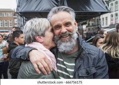 ROERMOND, NETHERLANDS - MAY 05, 2017: Happily married middle aged couple at a liberation feast in the city center