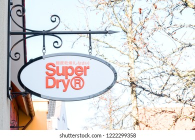 Roermond-Netherland : February 16, 2018 :  Outdoor Superdry shop at  Designer Outlet Roermond  shopping center, people shopping in sale day. Grain noise effect