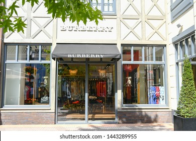 Roermond-Netherland : July 4, 2019 : Outdoor Buberry store at  Designer Outlet Roermond shopping center in summer season ,Shopping summer sale concept, Grain noise effect