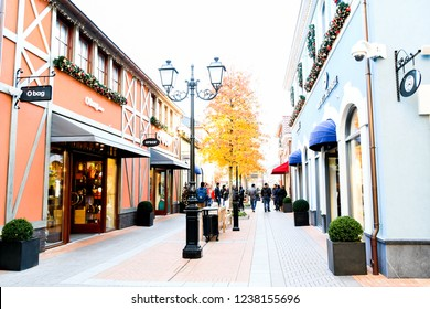 Roermond-Netherland : November16, 2018 : Outdoor environment at Designer Outlet Roermond  shopping center in autumn season with yellow green leavesShopping in black Friday concept, Grain noise effect