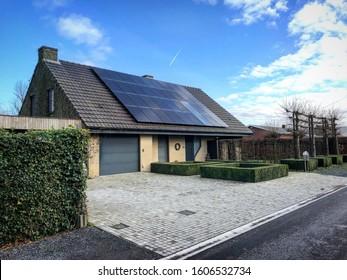 Roeselare / Belgium - January 5 2020: black solar panels on roof of modern Flemish Belgian European house