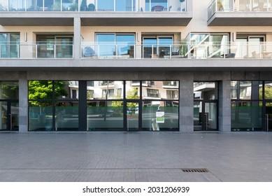 Roeselare, East Flemish Region - Belgium - 07 19 2021: Rectangular contemporary facade of an apartment block