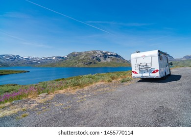 ROGALAND, NORWAY - JULY 27, 2018: Camper parked in front of the rough southern Norway landscape of Rogaland