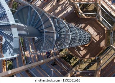 Rogla, Slovenia - Oct 13 2019: People walk on tall lookout tower on a tree canopy walk, treetop walkway, footbridge through the forest on Rogla, Pohorje mountain, Slovenia
