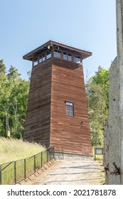 Rogoznica, Poland - June 3, 2021: Guard tower and barbed wire around Gross-Rosen Nazi concentration camp. Gross-Rosen was a network of Nazi concentration camps built and operated by Nazi Germany.