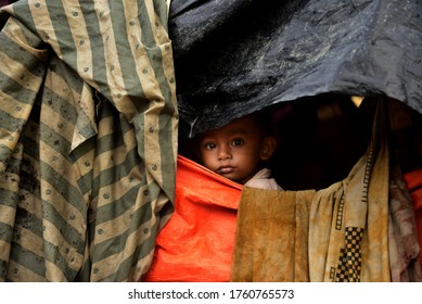 Rohingya child looks outside from their makeshift house at the Thangkhali makeshift Camp in Cox's Bazar, Bangladesh, on October 08, 2017.