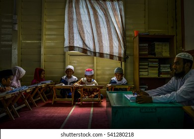 Rohingya Children recite the Koran at the Madrasah Rahmaniyah manage by Parents Association of Rohingya on December 16, 2015 in Klang Selangor, Malaysia.