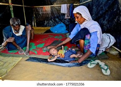 A Rohingya refugee family member sits in their house at the palongkhali makeshift Camp in Cox's Bazar, Bangladesh, on September 06, 2017