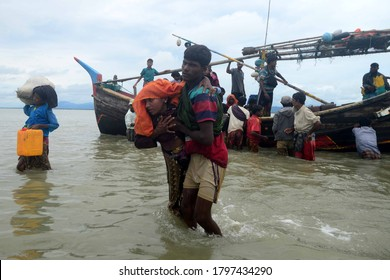 Rohingya refugees cross into the mainland after arriving in Bangladesh on September 10, 2017 in Shah Porir Dwip Bangladesh. Nearly 400,000 Rohingya refugees have fled into Bangladesh since late August