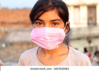 Rohtak, Haryana, India - September 10, 2020: Elementary age child wearing mask portrait close up.