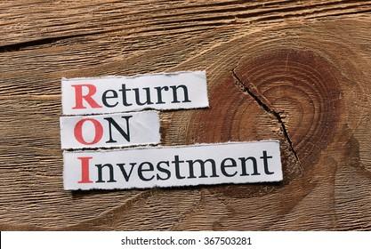 ROI acronym  Return On Investment on paper on wood