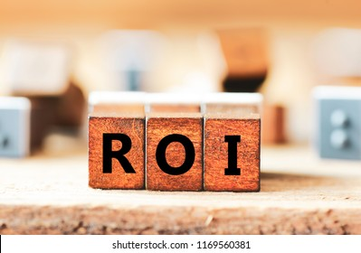 ROI. Wooden cubes with letters ROI