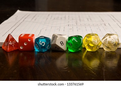 Role Play Dice on wooden table top with a map in the background