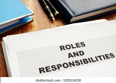 Roles and Responsibilities documents on a desk.