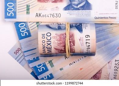 roll of 500 pesos bills on bills, all of 500 Mexican pesos