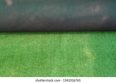 Roll of artificial green plastic grass