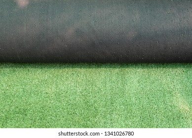 Roll of artificial green plastic turf