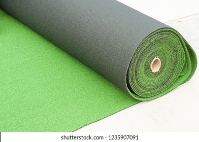 Roll of artificial turf on ground