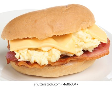 Roll with bacon, scrambled egg and processed cheese.