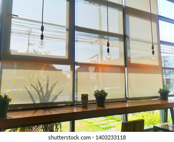 Roll Blinds on the windows, the sun does not penetrate the house. Window in the Interior Roller Blinds. Beautiful Blinds on the Window, the Sun and Heat Protection, the Perfect Windows Interior Decor.