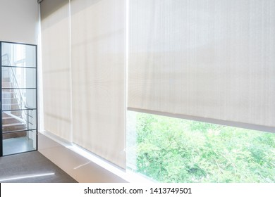 Roll Blinds on the windows, the sun does not penetrate the house. Window in the Interior Roller Blinds. Beautiful Blinds on the Window