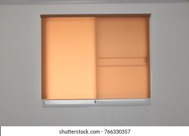 roll blinds with yellow sunscreen.
