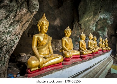 Roll of Buddha statue in the cave