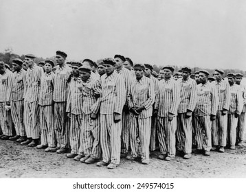 Roll call at Buchenwald concentration camp, ca.1938-1941. Two prisoners in the foreground are supporting a comrade, as fainting was frequently an excuse for the guards to 'liquidate' useless inmates.