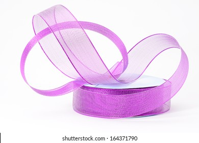 A roll of decorative florist purple ribbon