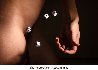 Roll the dice on the background of a naked female body.