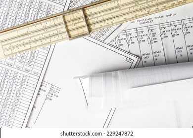 Roll of drawing and slide rule on the scheme