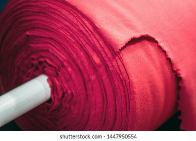 roll with fabric for sewing in a shop or factory. Textile production