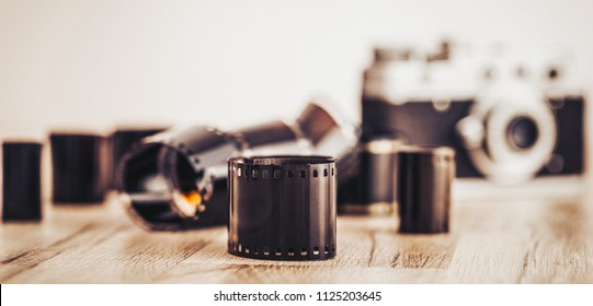 Roll of films and 35mm camera. Vintage illustration.