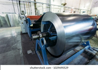 Roll of galvanized steel sheet feeds steel sheets to the cutting machine for manufacturing metal pipes and tubes in the factory