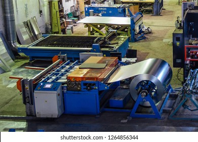 Roll of galvanized steel sheet for manufacturing metal pipes and tubes in the factory.
