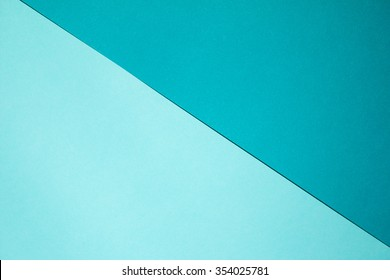 Roll green paper on blue background.