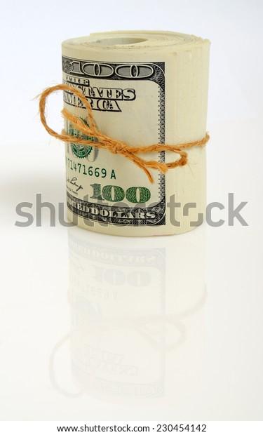 Roll of hundred dollar bills on a light plane.