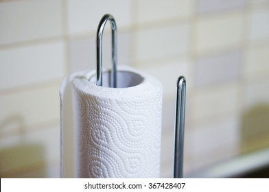 Roll of kitchen paper in a metal holder