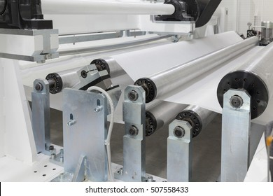 roll machines for cutting and rewinding of paper