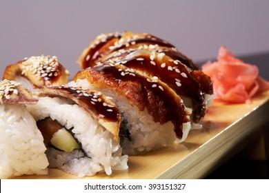 Roll made of Fresh Raw Salmon Smoked Eel, Cream Cheese and Avocado inside. Topped with Smoked Eel unagi