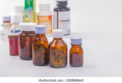 roll of medicine bottle on white background.