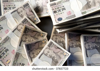 A lot of roll of money are placed on the desk.