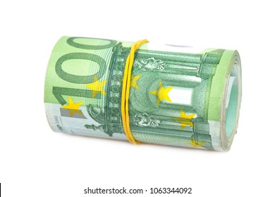 Roll of one hundred euro banknotes with a rubber band, isolated on the white background, clipping path included. Full focus.