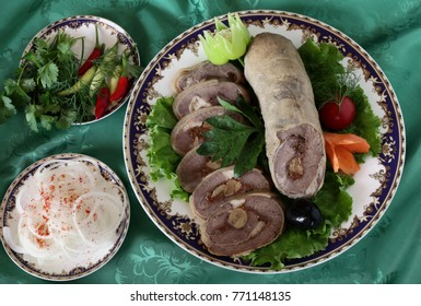 Roll of peritoneum with garlic and spices.The upper projection.Uzbek cuisine.