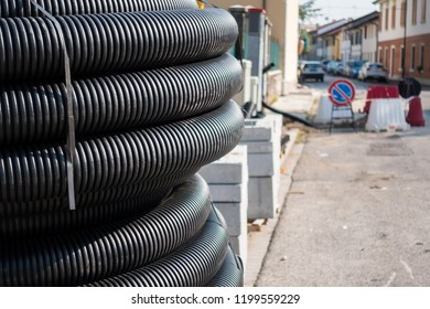 Roll of plastic pipe for road works. Protection of electric or telephone cables.