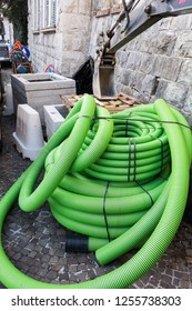 Roll of plastic pipe for road works. Protection of electric or telephone cables