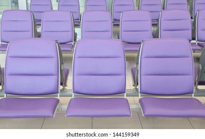 roll of purple chair at the airport